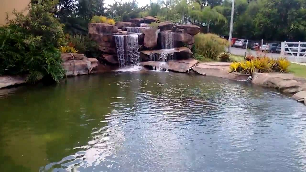 artificial lake with waterfall