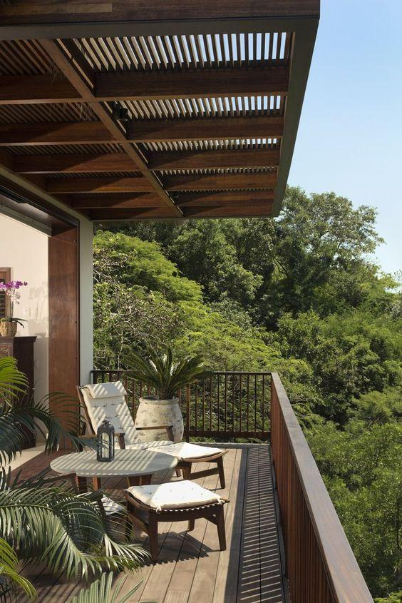 Balcony with armchairs and beautiful view of the local vegetation.