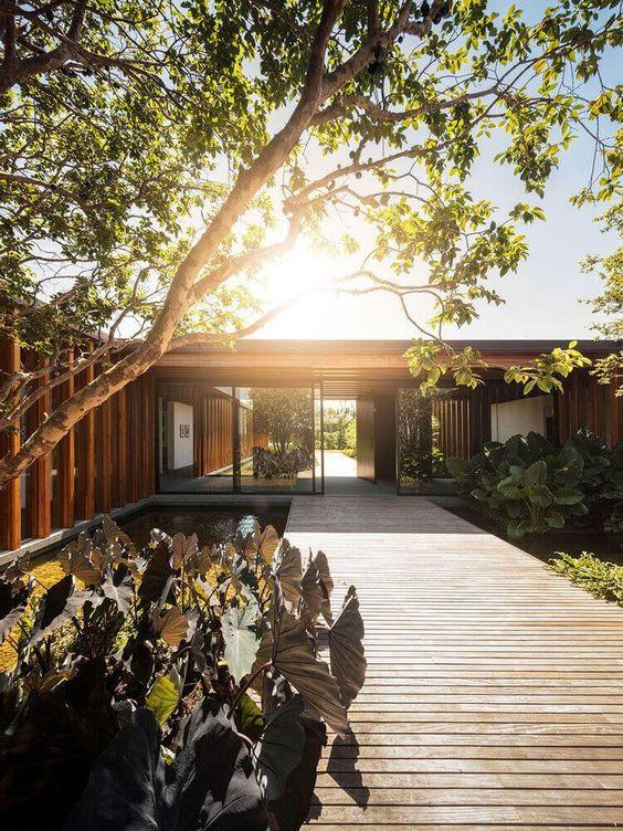 Beautifully landscaped construction and wooden deck backing the path.