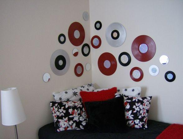 Painted vinyl records are used as wall decor.