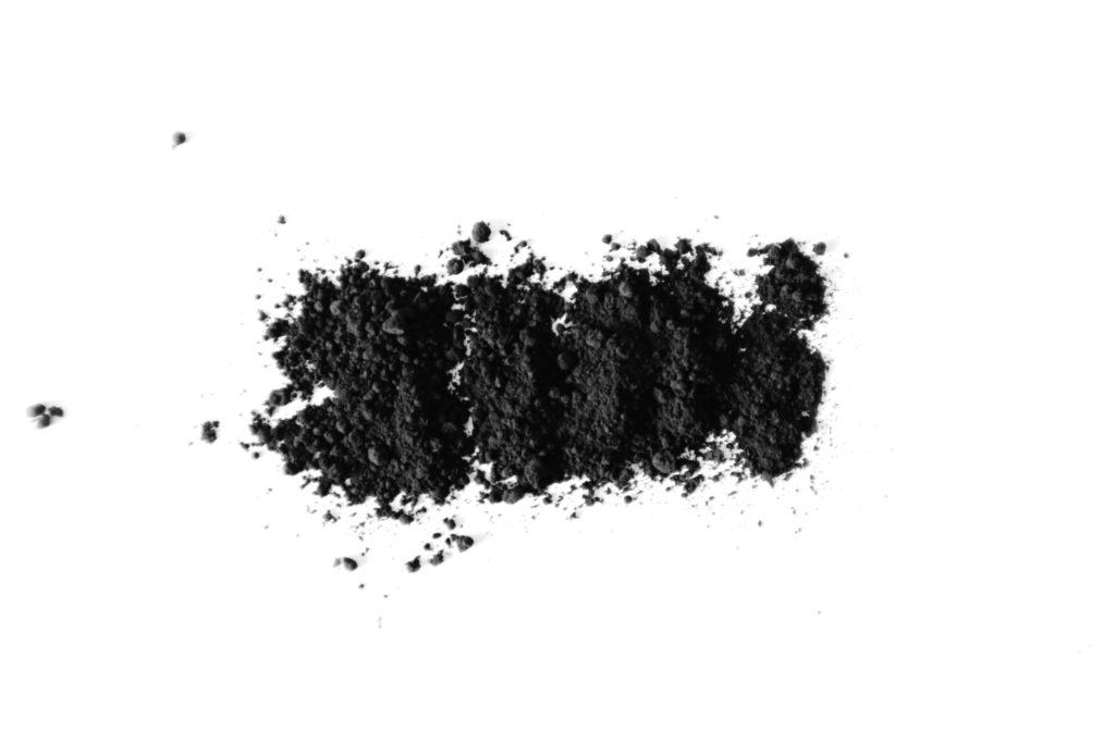 Powdered charcoal, an ingredient that absorbs bad smells.