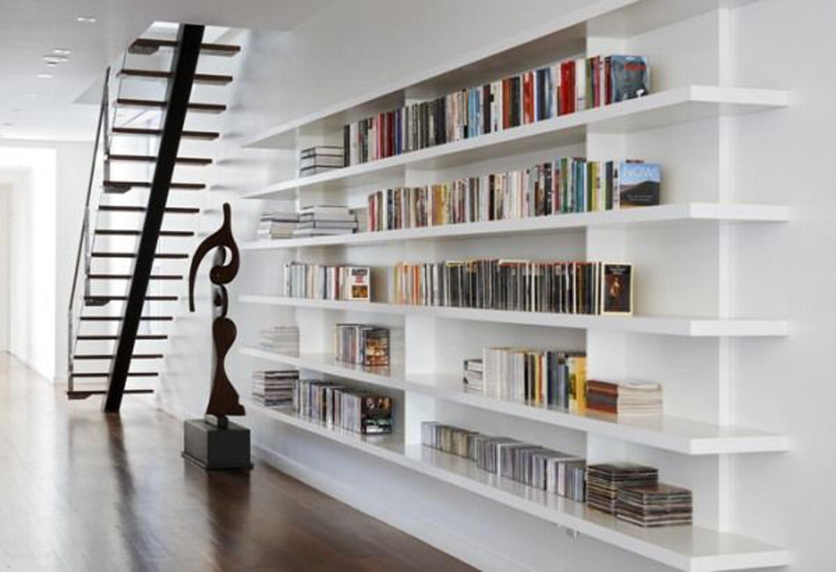 The home library can be placed under the stairwell.