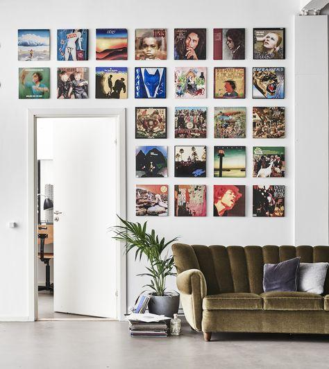 Vinyl records arranged neatly on the wall as a living room decor.
