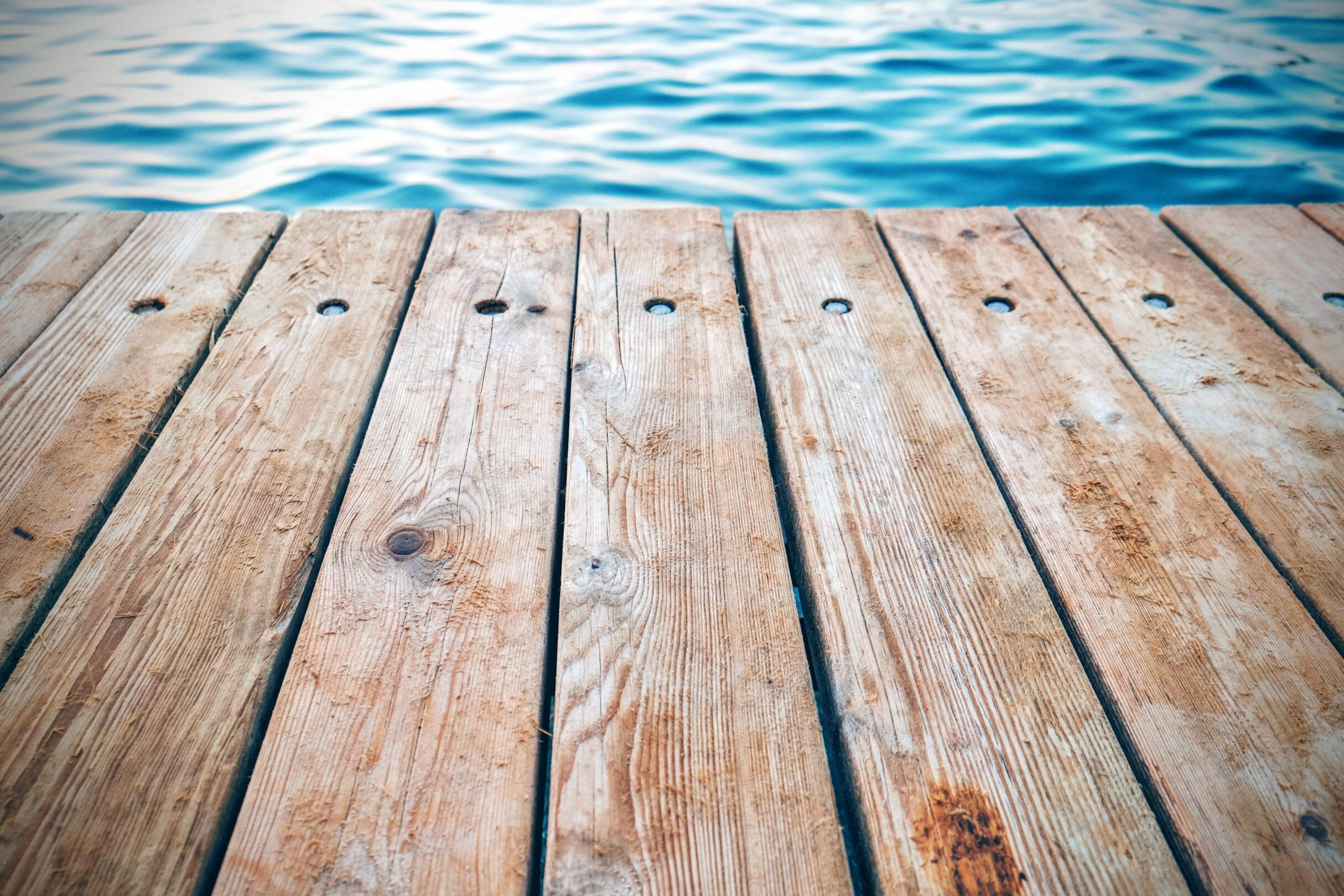 Wooden deck at the water's edge.
